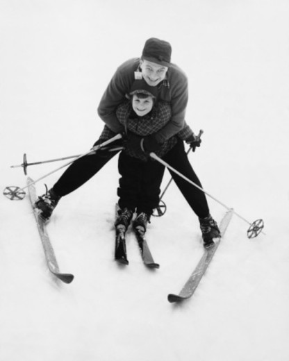 Man teaching boy to ski : Stock Photo