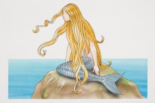 Blonde mermaid sitting on sea rock, side view. : Stock Photo