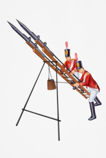 Napoleonic era British foot Soldiers assembling rocket system : Stock Photo