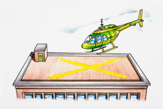 Helicopter landing on helipad on top of building : Stock Photo
