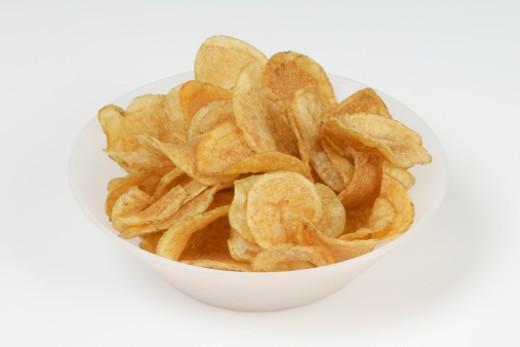 Bowl of crisps, studio shot : Stock Photo