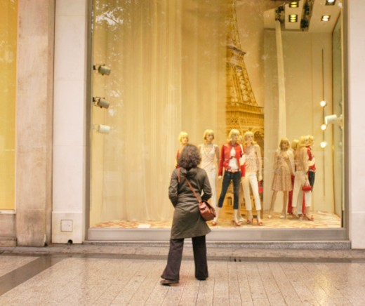 Stock Photo: 4268R-3221 France, Paris, woman looking at window display