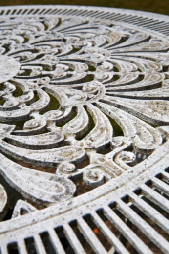White cast iron garden table, close-up : Stock Photo