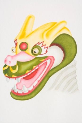 Head of colourful papier-mache dragon, side view. : Stock Photo