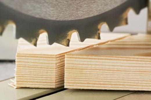 Circular saw and timber, close up : Stock Photo