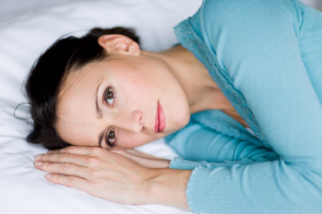 Woman resting in bed. : Stock Photo