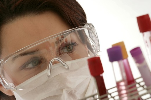 Lab assistant carrying blood tubes to be analyzed. : Stock Photo
