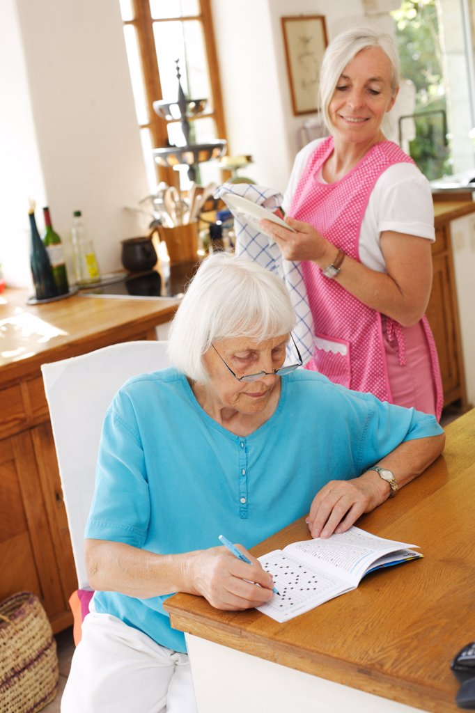 Stock Photo: 4269-11855 80 years old woman with a home care attendant.