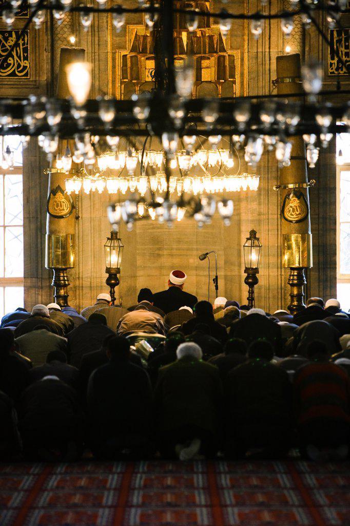 Stock Photo: 4269-12046 Faithfuls praying in Yeni Cami, the New Mosque, Istanbul, Turkey.
