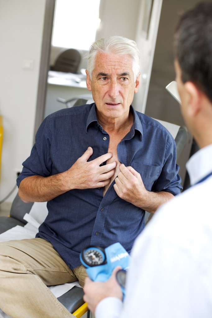 Stock Photo: 4269-12184 Doctor talking with a senior patient during medical consultation.