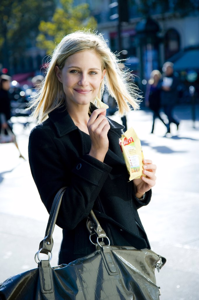 Woman eating potato chips. : Stock Photo