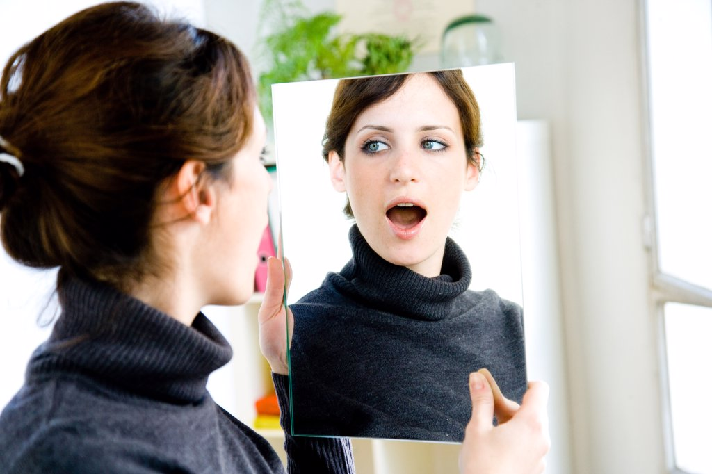 Treatment of stuttering : woman doing articulation and breathing exercises. : Stock Photo