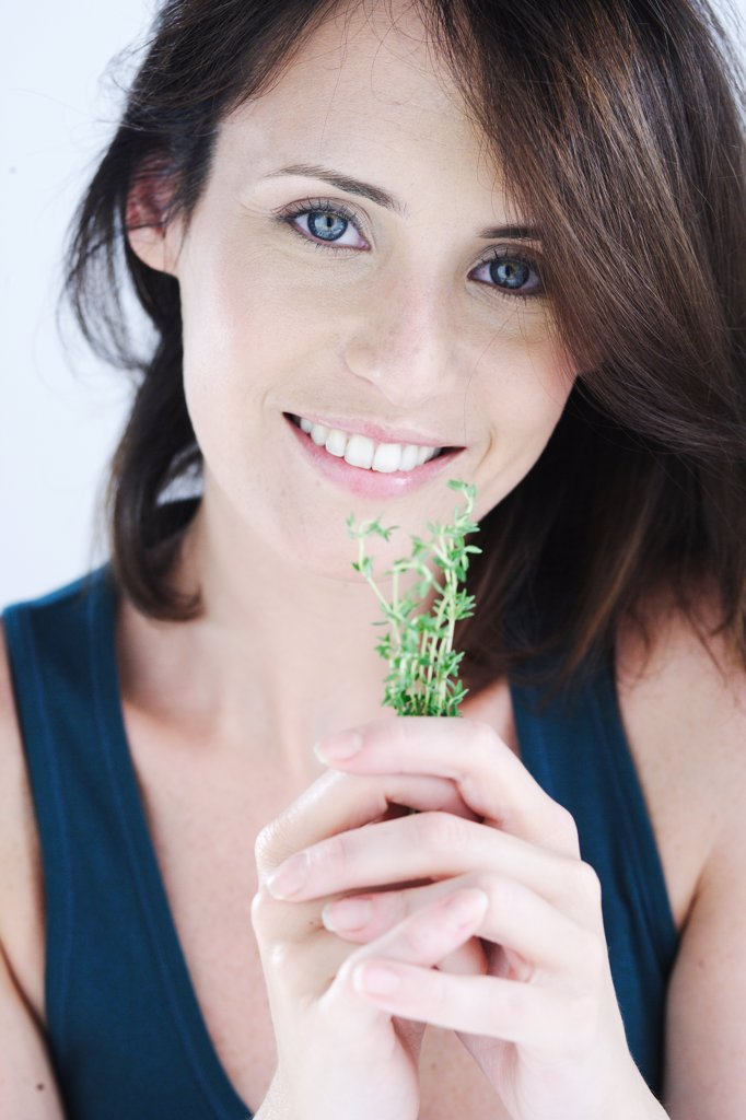 Woman inhaling thyme fragrance. : Stock Photo