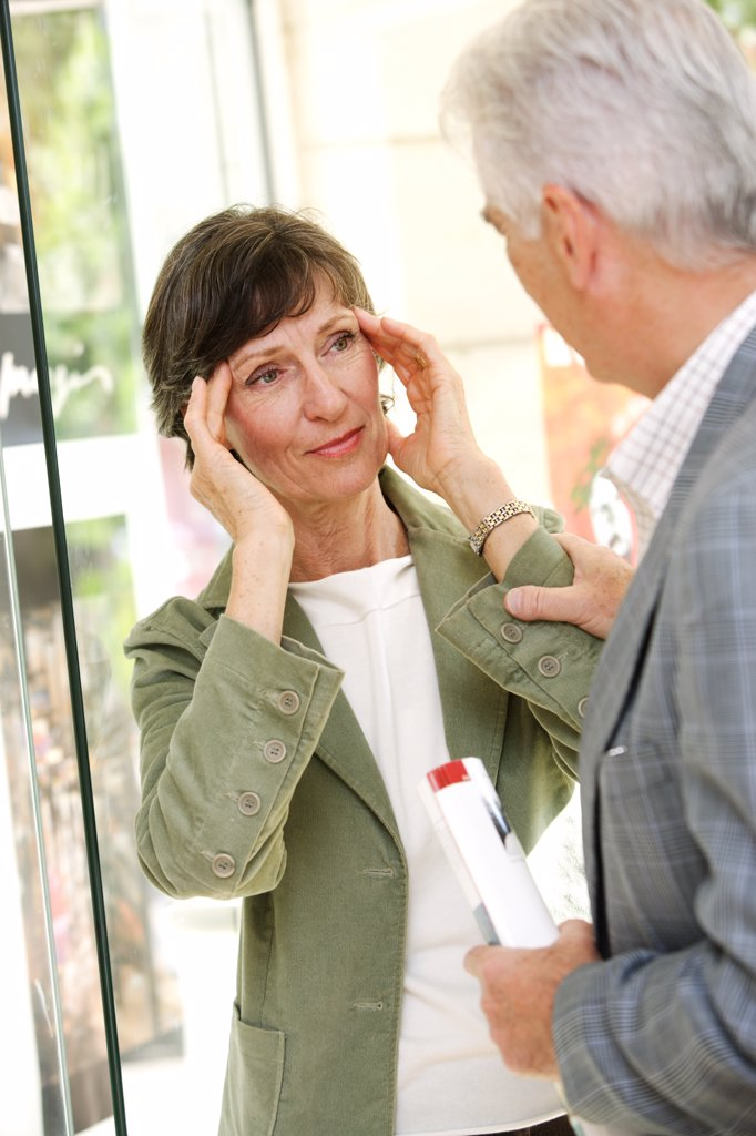 Senior woman feeling dizzy. : Stock Photo