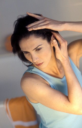 Stock Photo: 4269-12659 Woman inspecting her scalp.