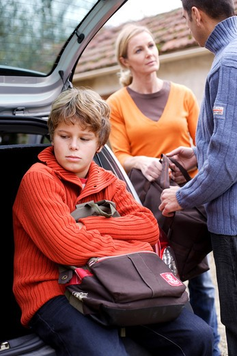 12 years old boy and parents with travel bags. : Stock Photo