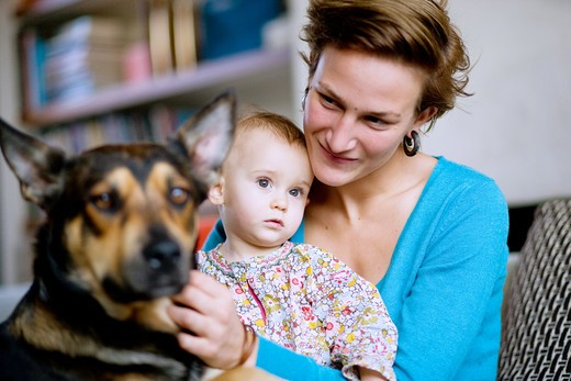Stock Photo: 4269-12960 Mother and her 12 months old baby with a dog.