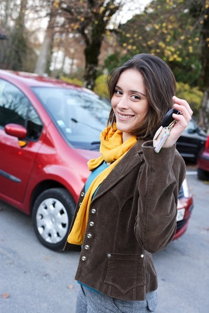 Woman holding car keys. : Stock Photo