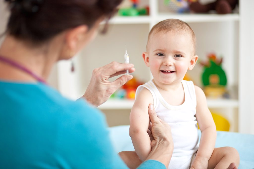 Stock Photo: 4269-13521 14 months old baby receiving vaccination.
