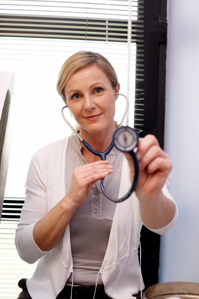 Stock Photo: 4269-13603 Portrait of a general practitioner with a stéthoscope.