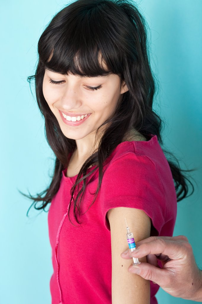 Stock Photo: 4269-14290 Teenage girl receiving vaccination against hepatitis B.