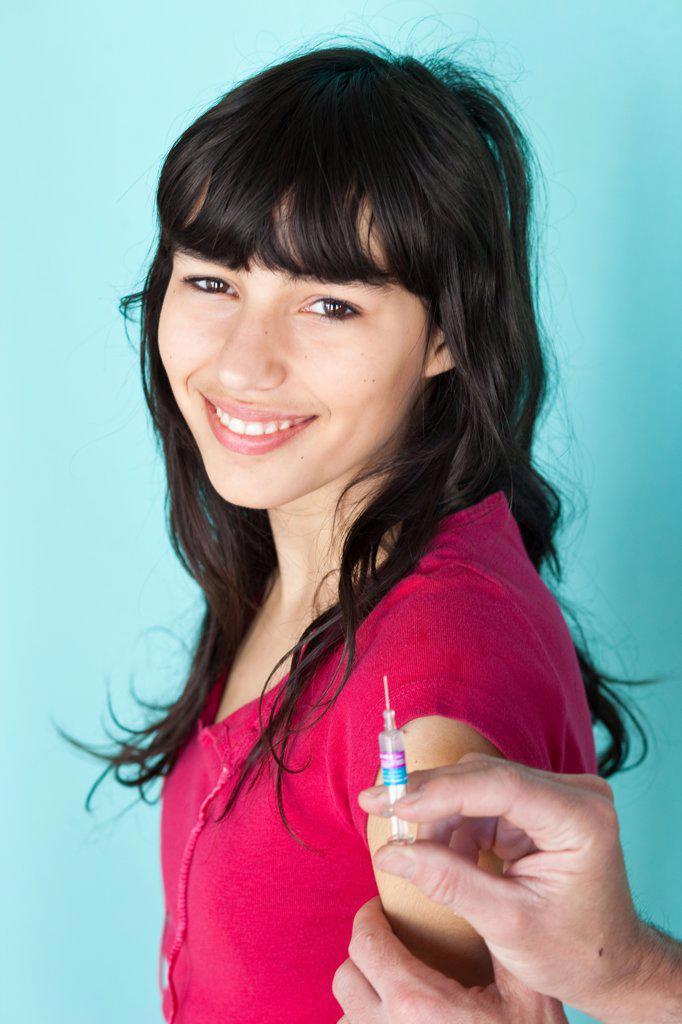 Teenage girl receiving vaccination against hepatitis B. : Stock Photo