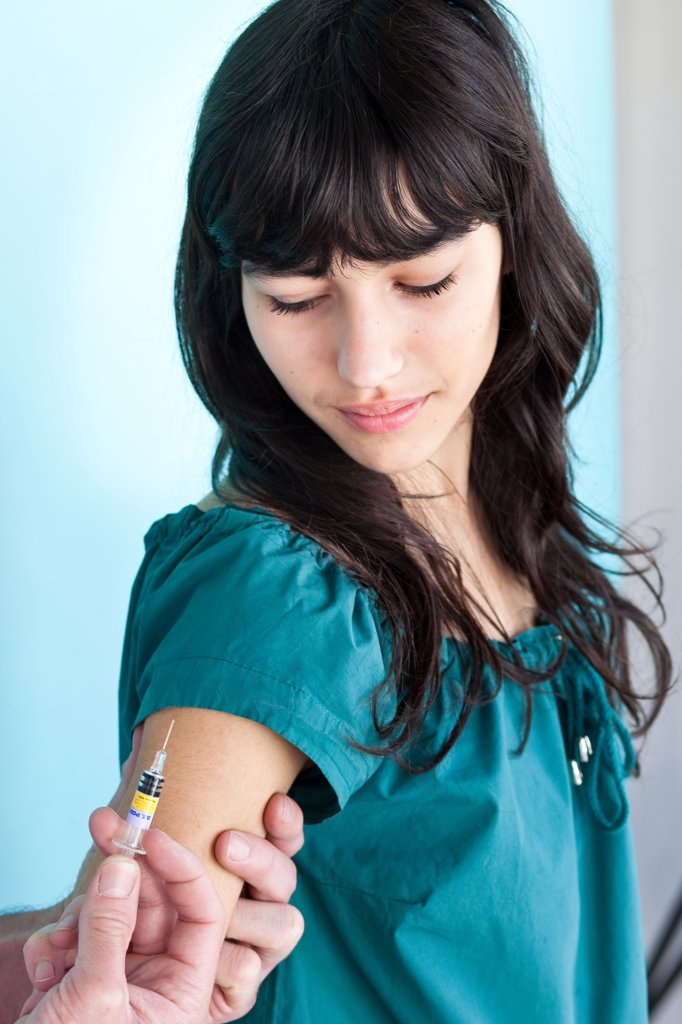 Stock Photo: 4269-14294 Teenage girl receiving vaccination against Tetanus, Diphtheria and Polio (TdP vaccine)