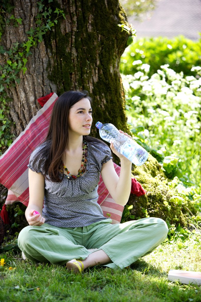 Stock Photo: 4269-14404 Young woman drinking mineral water.