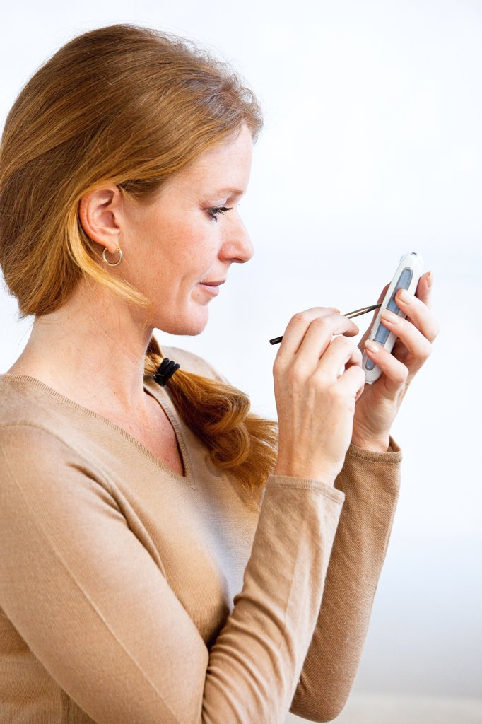 Stock Photo: 4269-14441 Woman using a smartphone.