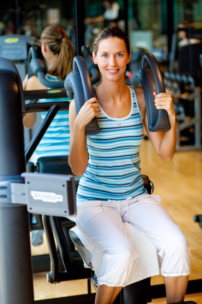 Woman doing abdominal crunch exercises at the gym. : Stock Photo