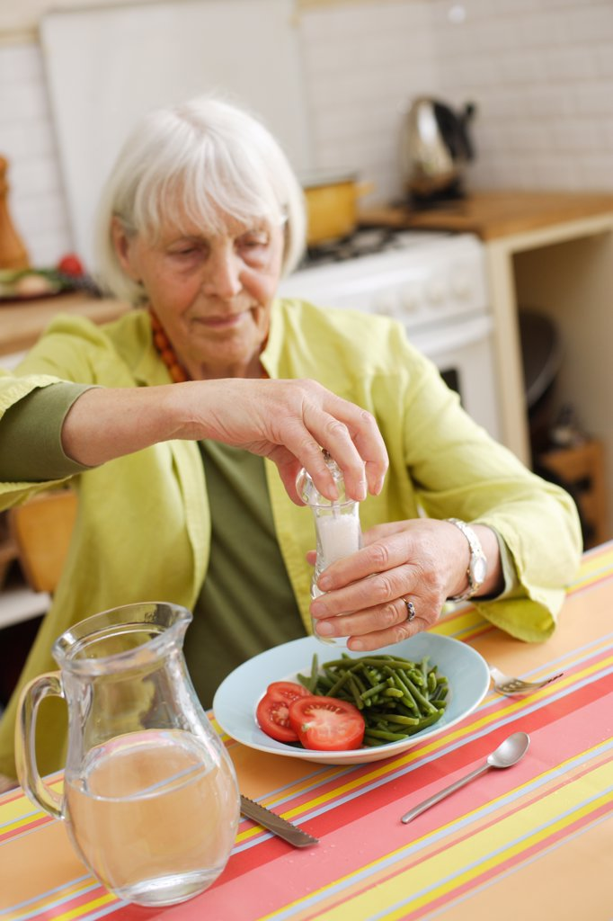 Stock Photo: 4269-14909 80 years old woman having lunch at home.