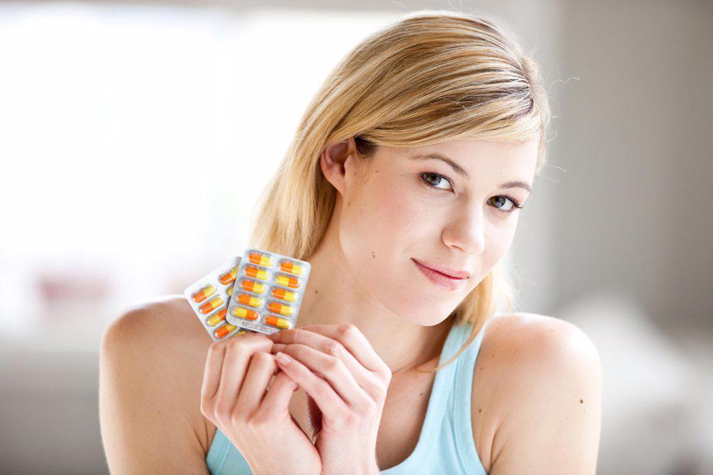 Stock Photo: 4269-15036 Woman taking medication.