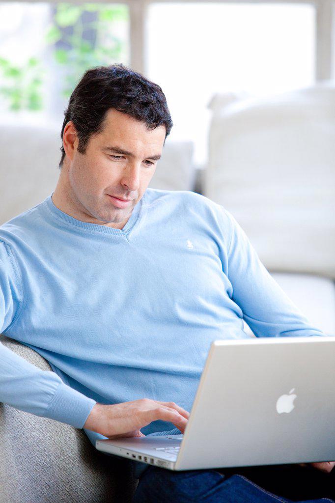 Man using his laptop computer. : Stock Photo