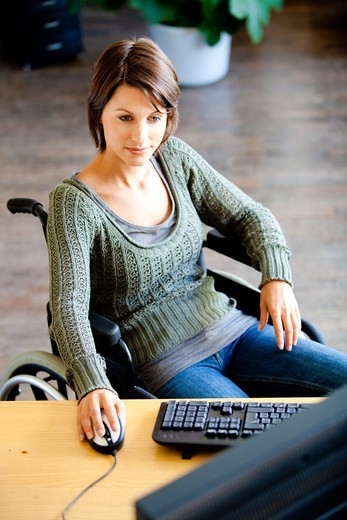 Stock Photo: 4269-15775 Woman in wheelchair working.