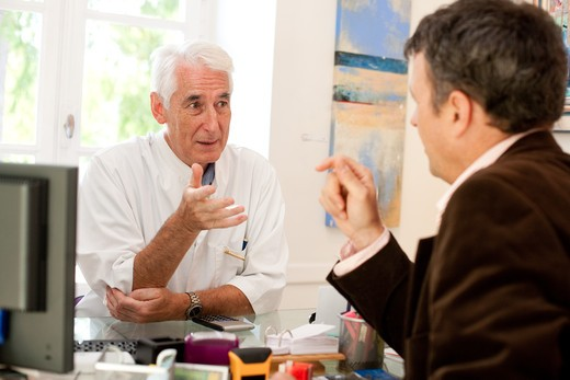 Stock Photo: 4269-15935 Doctor talking with a patient during medical consultation.