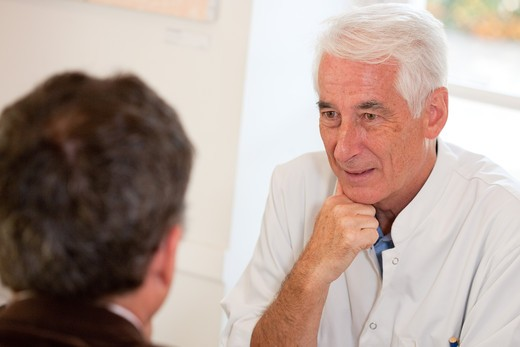 Stock Photo: 4269-15936 Doctor talking with a patient during medical consultation.