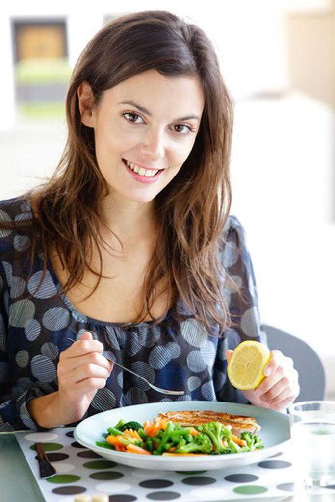 Woman eating fish. : Stock Photo