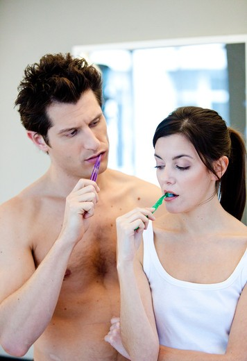 Stock Photo: 4269-16775 Couple brushing teeth.