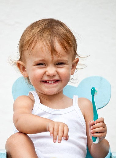 20 months old baby girl brushing her teeth. : Stock Photo