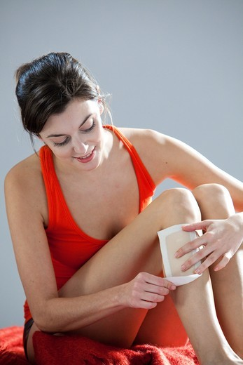 Woman wax epilation her legs. : Stock Photo