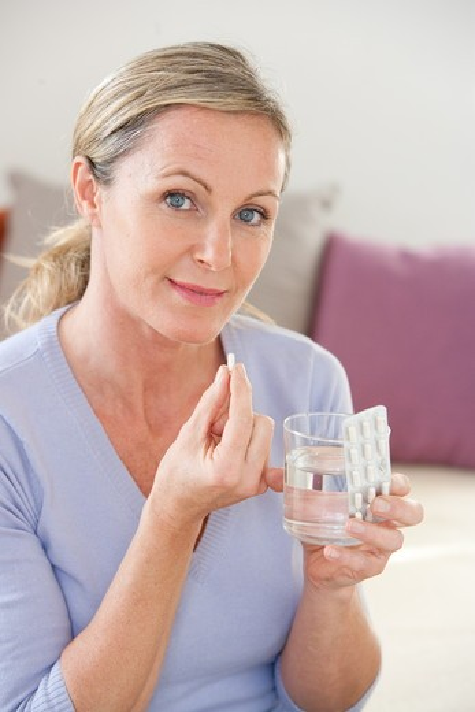 Woman taking medicine. : Stock Photo