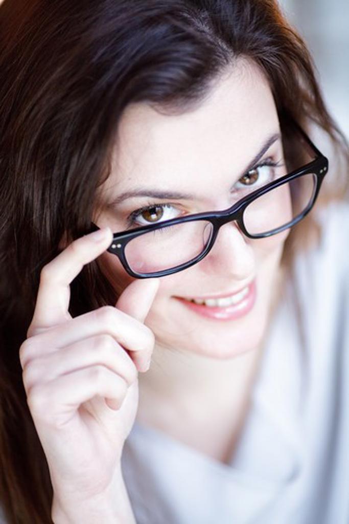 Stock Photo: 4269-17946 Woman wearing prescription glasses.