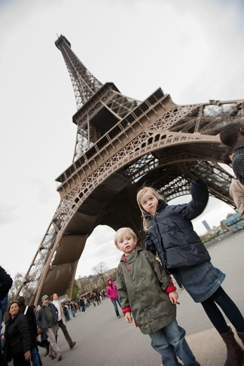 Stock Photo: 4269-18662 Brother and sister at the Eiffel Tower, Paris, France.
