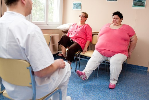 Stock Photo: 4269-18917 Female patients following an exercise program with a physiotherapist. Limoges hospital offers its obese patients requiring hospitalization for five days for a multidisciplinary management of obesity. Department of Internal Medicine, Endocrinology, Diabetes and Metabolic Diseases. Limoges, France.