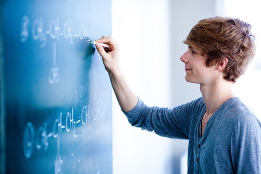 Teenage boy in a classroom. : Stock Photo