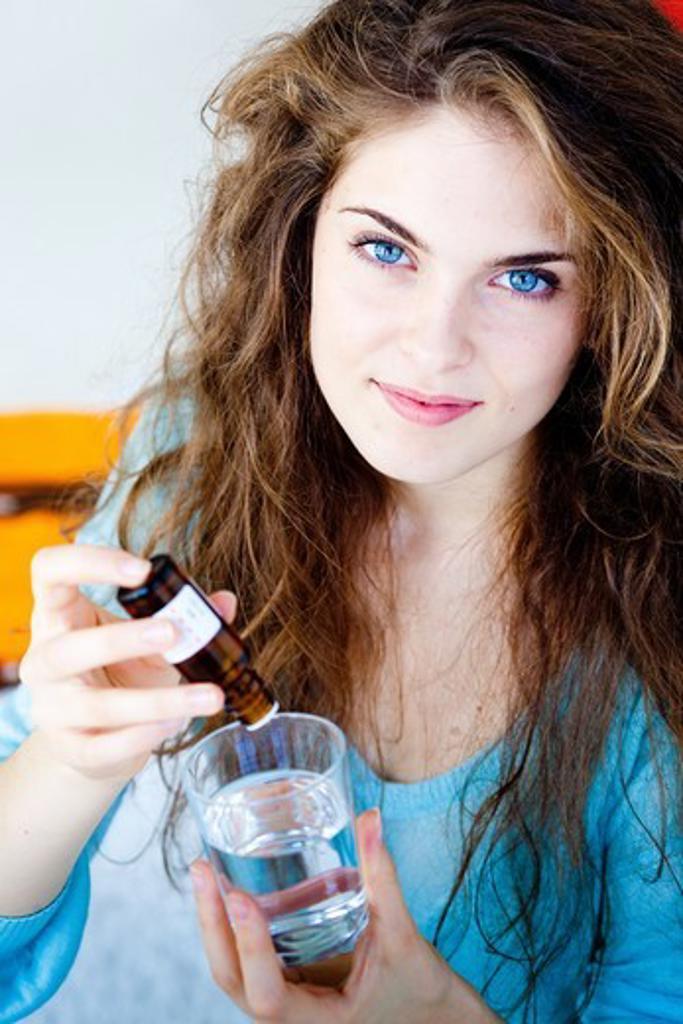 Woman taking vitamin D. : Stock Photo