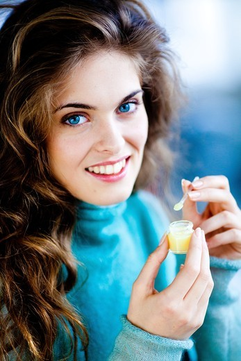 Stock Photo: 4269-21037 Woman eating royal jelly.