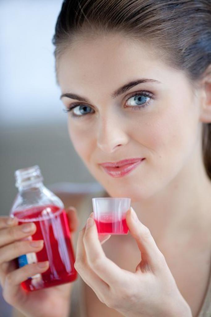 Stock Photo: 4269-22067 Woman having a mouthwash.