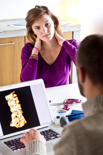 Woman consulting for neck pain. : Stock Photo