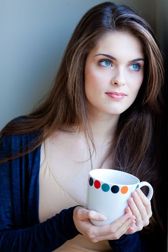 Stock Photo: 4269-22998 Woman drinking hot beverage.